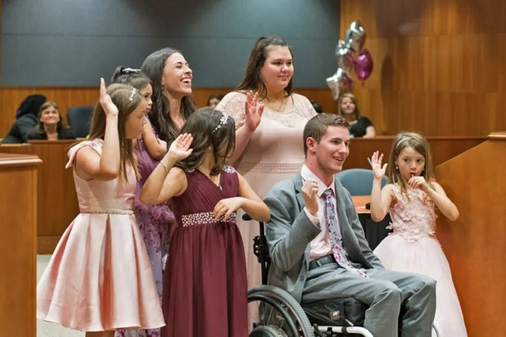 Footballer Who Became Confined to a Wheelchair Adopted Four Sisters With His Childhood Sweetheart 36